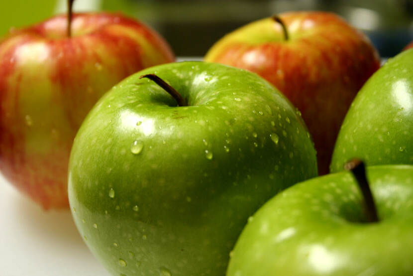 A photo of fresh green and red apples