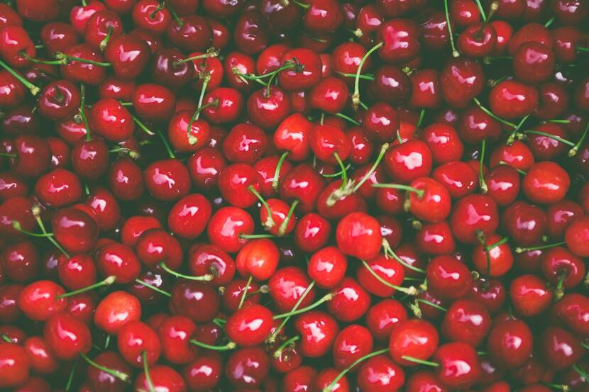 Picture of pile of fresh, ripe, red cherries