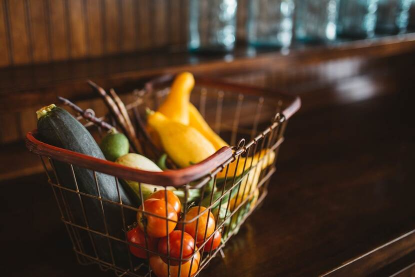 A shopping basket with vegetables