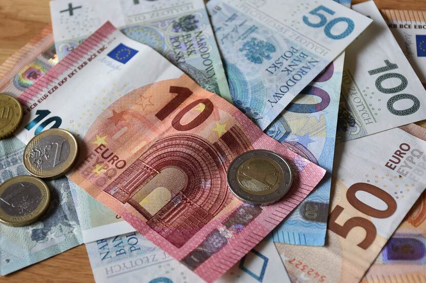 Euro and Polish zloty mixed with each other