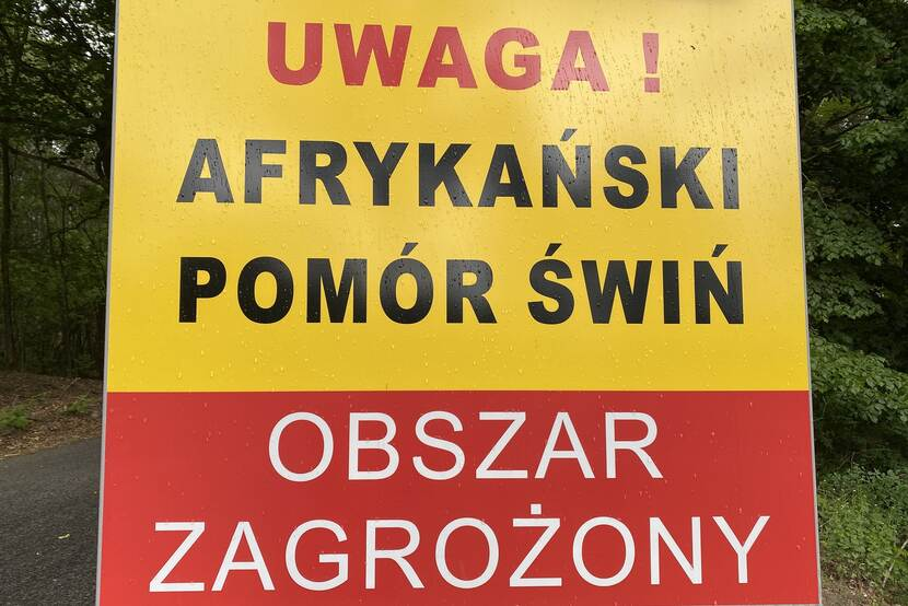board with warning about ASF zone in Poland