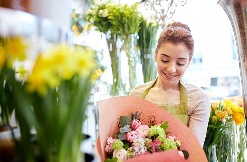 lady holding flower bouqet in a flower shop
