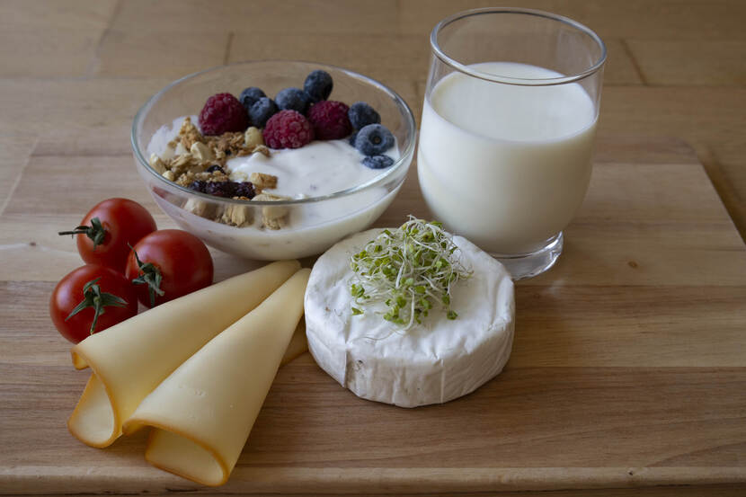 wooden plate with dairy products