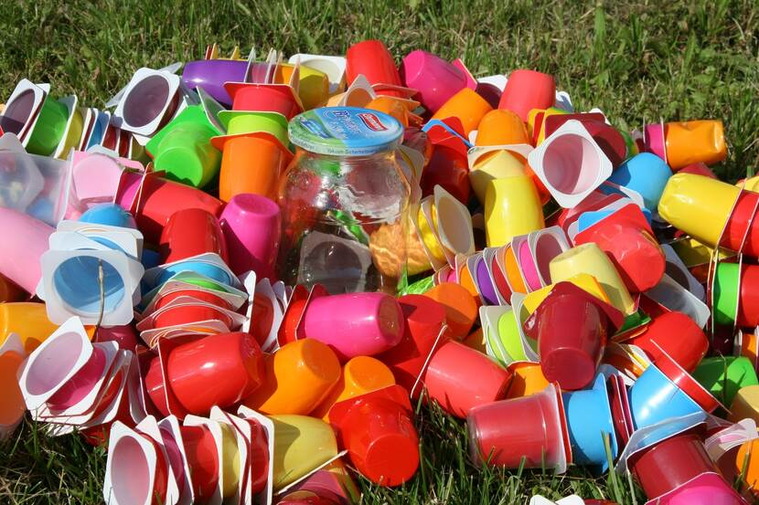 Empty reusable plastic cups laid out in a pile