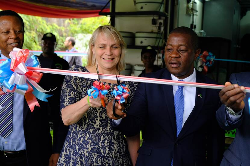 Cutting the ribbon of the mobile lab
