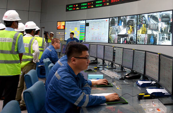 Specialists work at  Vinh Tan Thermal Power Plant