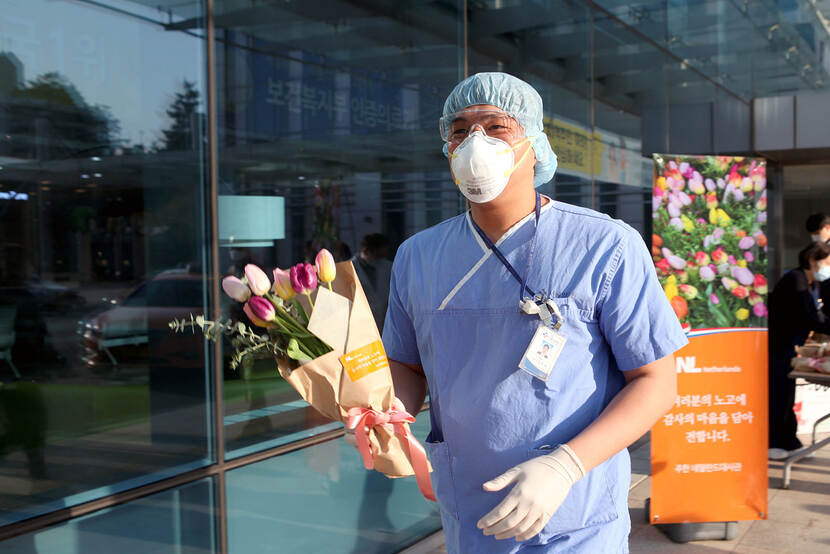 Medical staff with tulip bouquet